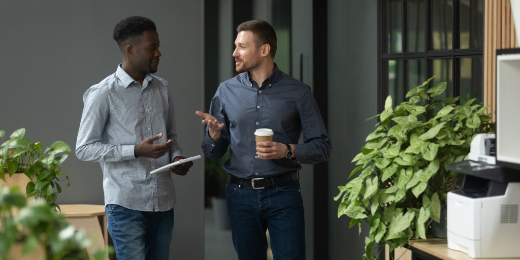 male co-workers chatting at work