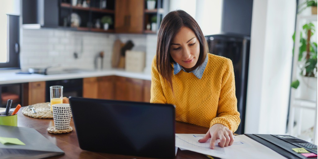 young-business-entrepreneur-woman-working-at-home-while-having